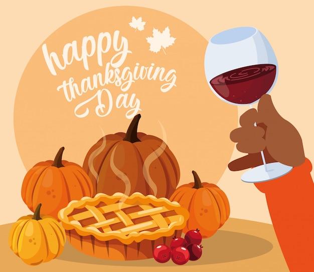 Ręka z kieliszkiem wina i jedzeniem dziękczynienia