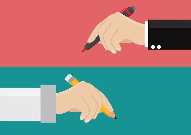 Ręka z piórem i ołówkiem.