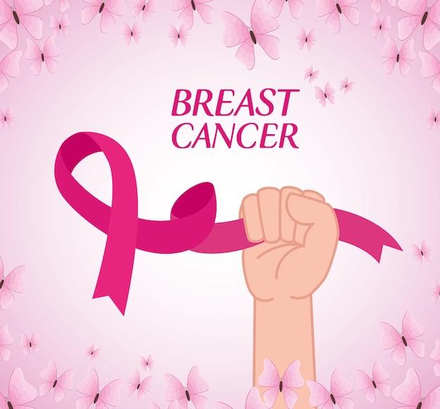 Ręka z różową wstążką, symbol światowego miesiąca świadomości raka piersi z dekoracją motyle