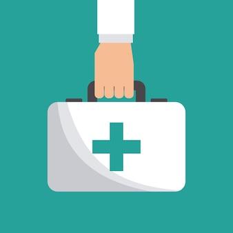 Ręka z teczką pierwszej pomocy