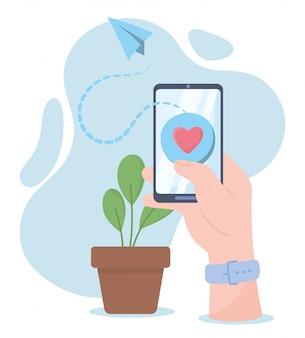 Ręka ze smartfonem miłość wiadomość komunikację społecznościową i technologie