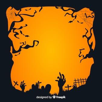Ręka zombie na cmentarzu o zachodzie słońca