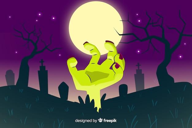 Ręka zombie na tle pełni księżyca