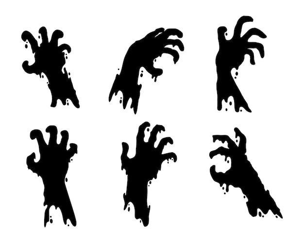 Ręka zombie wyłaniająca się z grobu. sylwetka ręki ducha w noc halloween