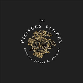 Ręki narysować ilustracja logo kwiaty hibiskusa. wieniec kwiatowy. botaniczny kwiatowy godło z typografią na czarnym tle.