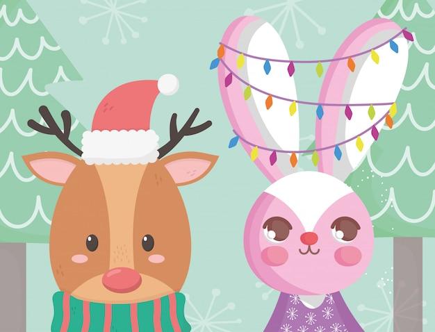Renifer z kapeluszem i królika światła kartki świąteczne