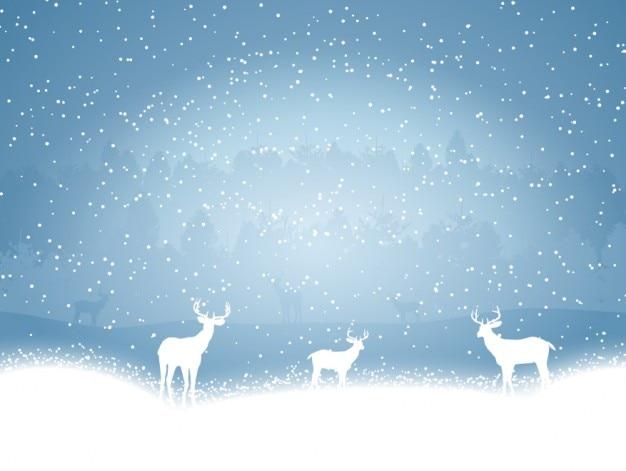 Renifery na śniegu niebieskim tle
