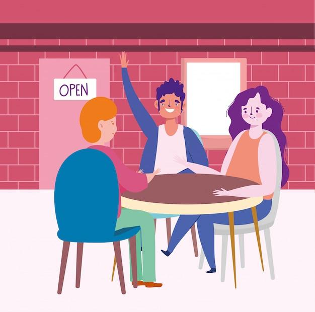 Restauracja lub kawiarnia zapewniająca dystans społeczny, szczęśliwi ludzie przy stole zachowują dystans
