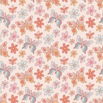 Retro bezszwowy wzór z motylami i kwiatami stokrotkami w ciepłej palecie kolorów