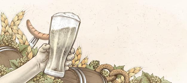 Retro drzeworyt ręka trzyma piwo