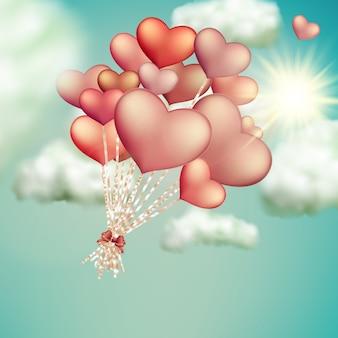 Retro miłość balony na niebieskim niebie.
