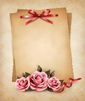 Retro różowa róża i stary papier.