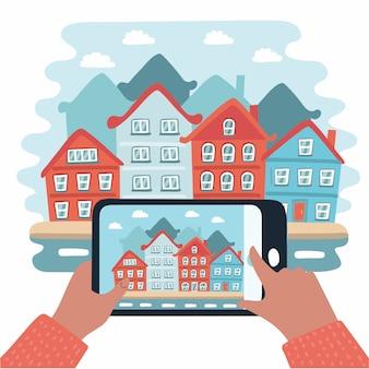 Robienie zdjęć na telefonie komórkowym. ręka trzyma telefon komórkowy