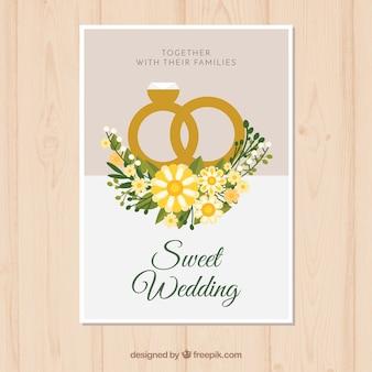 Rocznica ślubu karta z pierścieniami w stylu płaski