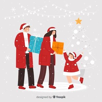Rodzice dają córce prezenty świąteczne