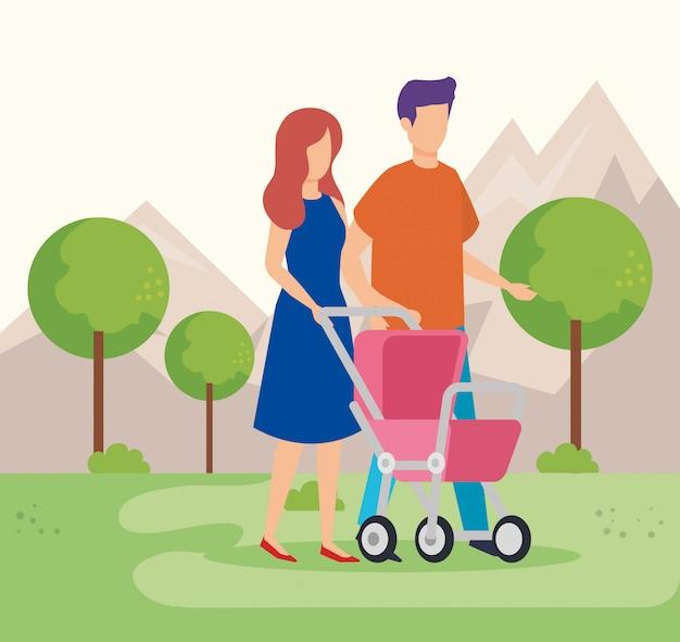 Rodzice dobierają się z wózka dzieckiem w parku