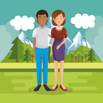 Rodzice para na zewnątrz w krajobrazie