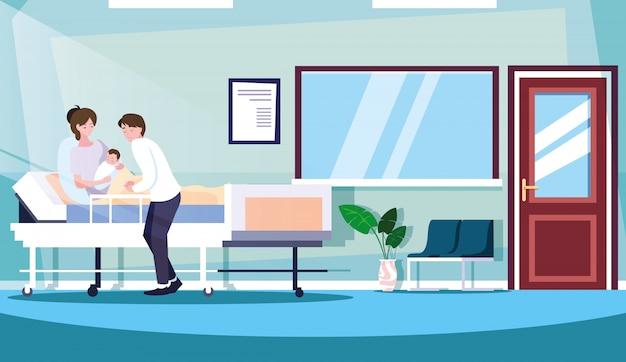 Rodzice z noworodkiem w sali hospitalizacji na noszach