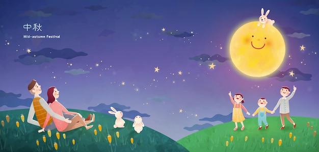 Rodzina ciesząca się oglądaniem księżyca i siedzeniem na zielonym polu