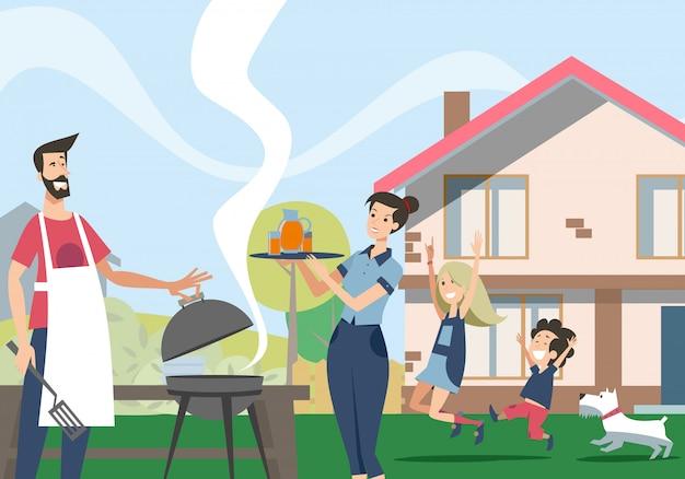 Rodzina cieszy się grilla w podwórku