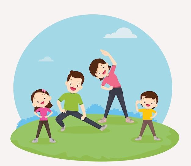 Rodzina ćwicząca razemszczęśliwa rodzina ćwicząca razem w publicznym parku dla dobrego zdrowia