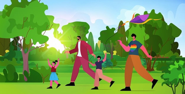 Rodzina gejów uruchamia latawiec z małymi dziećmi w parku ojcostwo transpłciowe miłość koncepcja społeczności lgbt