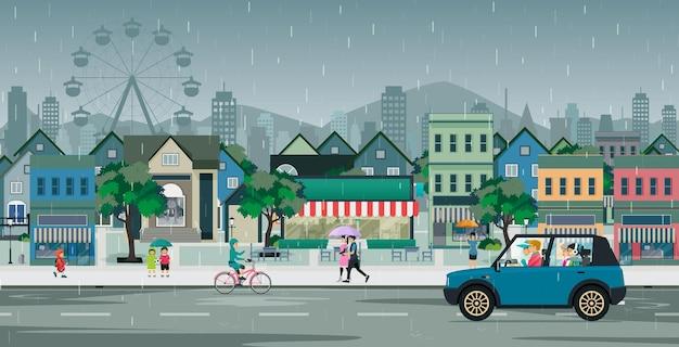 Rodzina jechała drogą, kiedy w mieście padał deszcz.