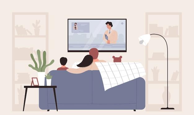 Rodzina ludzi oglądających telewizję