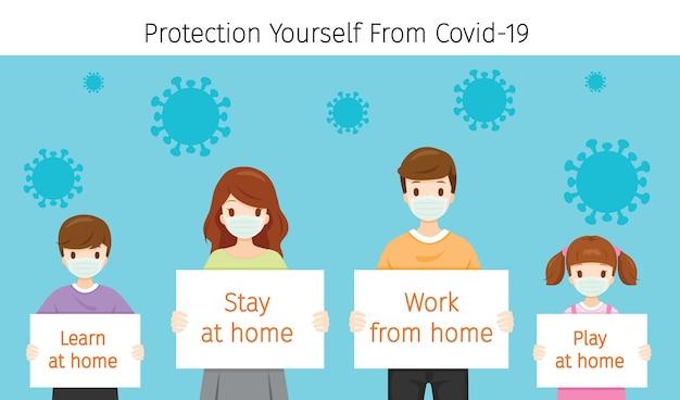 Rodzina nosząca maski chirurgiczne, trzymająca banery, zostań, ucz się, baw się w domu i pracuj z domu