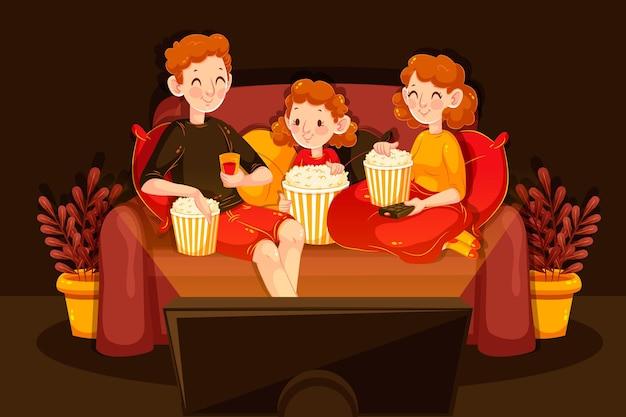 Rodzina ogląda film na kanapie