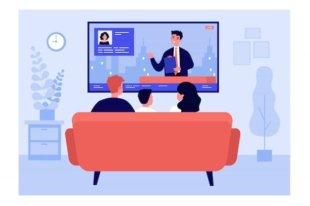 Rodzina ogląda wiadomości w salonie