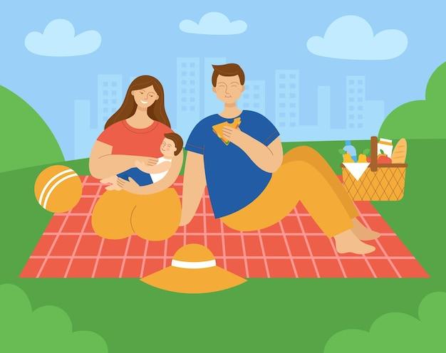 Rodzina siedzi na kratę w parku mama tata i dziecko koncepcja pikniku rodzinne wakacje o