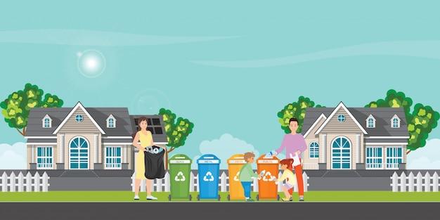Rodzina sortuje śmieci do śmietnika.