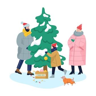 Rodzina stojący na choince. matka, ojciec i syn w ciepłych ubraniach dekorują drzewo na zewnątrz tradycyjnymi dekoracjami świątecznymi. szczęśliwi ludzie. ilustracja w stylu