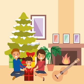 Rodzina świętuje boże narodzenie wpólnie drzewnego komin i muzykę