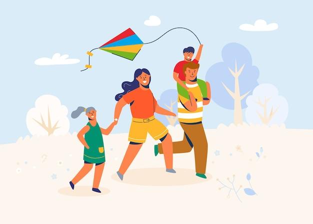 Rodzina w parku uruchamia latawiec. ojciec, matka i dzieci postacie biegające na świeżym powietrzu, bawiące się zabawką wiatrową w weekendy, wakacje, wakacje.