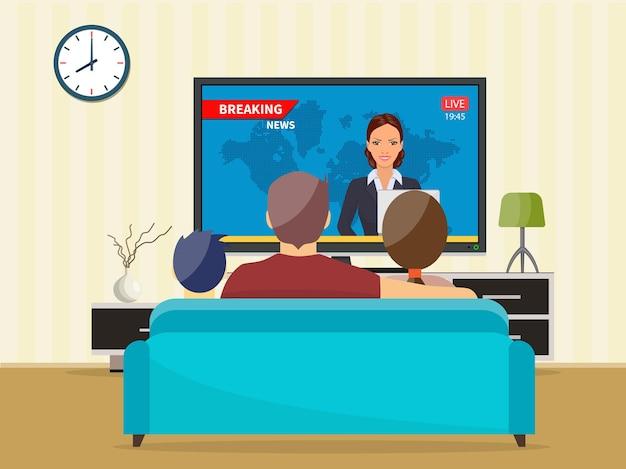 Rodzina z kotem ogląda codzienne wiadomości w telewizji