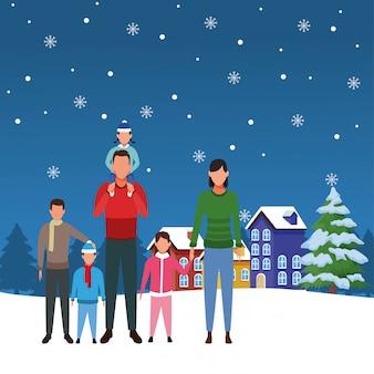 Rodzina z małymi dziećmi w śnieżnym krajobrazie