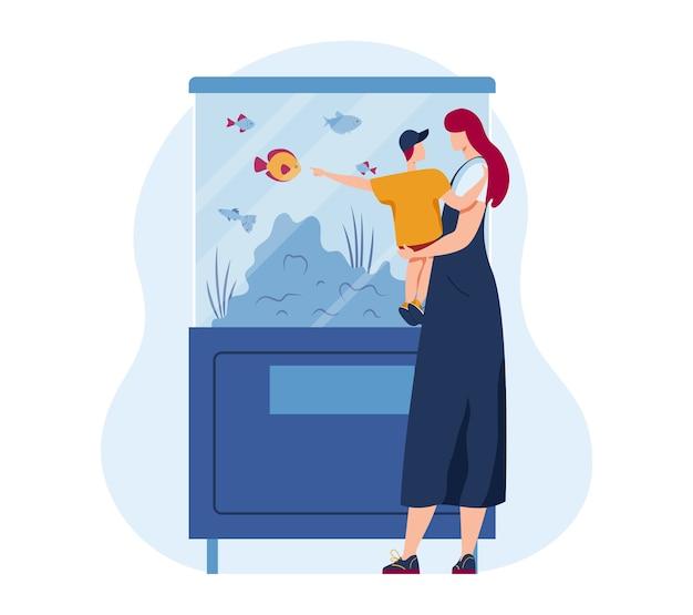 Rodzinne zwierzę w akwarium kreskówki, ilustracja. zwierzęta morskie w wodzie, złote rybki wodne i tropikalne ryby oceaniczne podwodne tło. matka, dzieciak postać patrzy przez szkło, chłopiec wybiera zwierzaka.