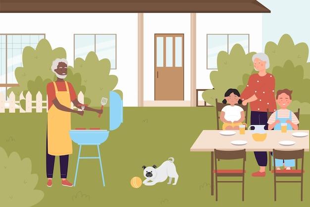 Rodziny gotują na imprezie piknikowej z grilla na podwórku