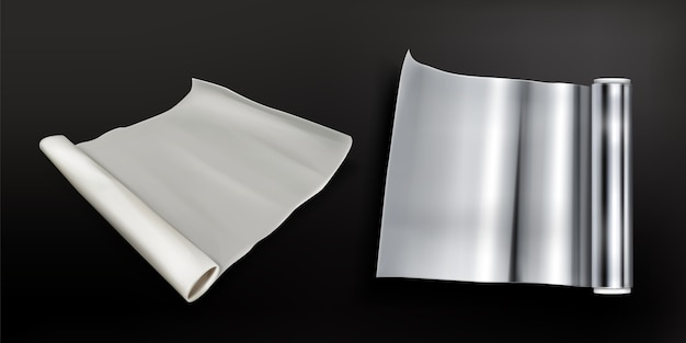 Rolki folii aluminiowej i papier do pieczenia na białym tle