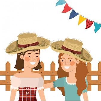 Rolnicy kobiety rozmawiają ze słomianym kapeluszem
