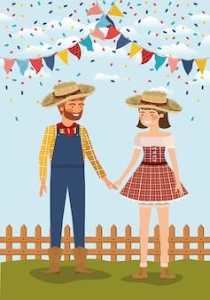 Rolnicy para świętuje z girlandami i ogrodzeniem