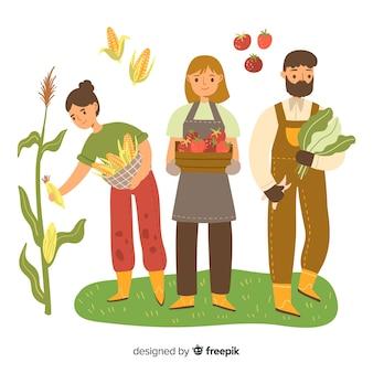 Rolnicy wspólnie wykonują prace rolnicze