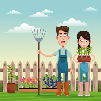 Rolnicy z widłami i puli pole roślin ogrodzenia