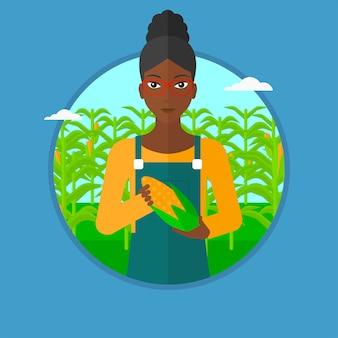 Rolnik gospodarstwa ilustracji wektorowych kukurydzy.