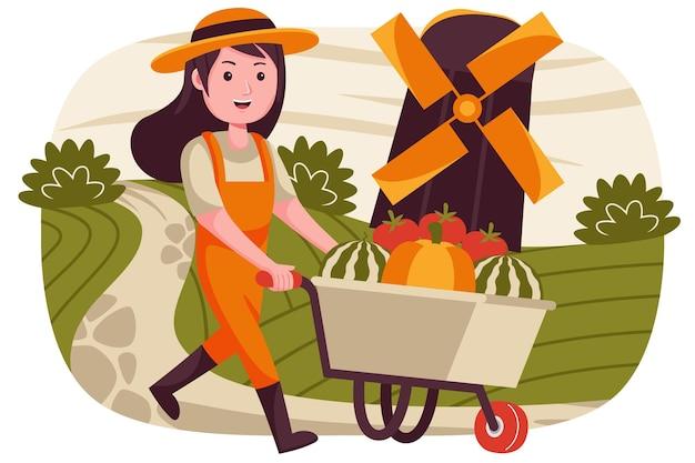 Rolnik kobieta ubrana w kombinezon z wózkiem sprzedającym arbuzy, pomidory i dynie.