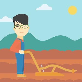 Rolnik na polu z pługiem