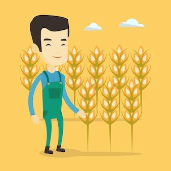 Rolnik w polu pszenicy