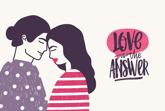 Romantyczna para na randce i fraza love is the answer napisana kursywą. przytulanie chłopaka i dziewczyny i odręczny napis